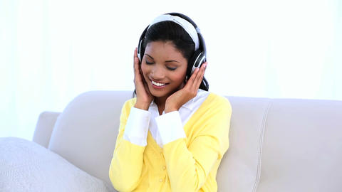 Woman wearing headphones for listening music on so Footage
