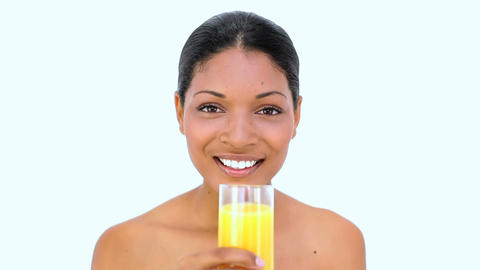 Beautiful woman drinking orange juice Footage