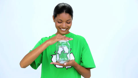 Ecological woman holding jar and does thumbs up at Footage
