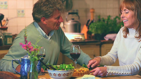 Mature couple having dinner together talking Footage
