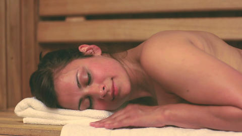 Brunette relaxing in the sauna Footage