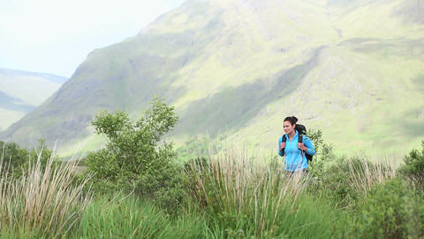 Active woman hiking on her own Footage