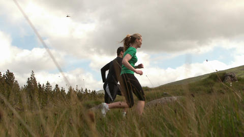 Athletic couple jogging uphill Footage