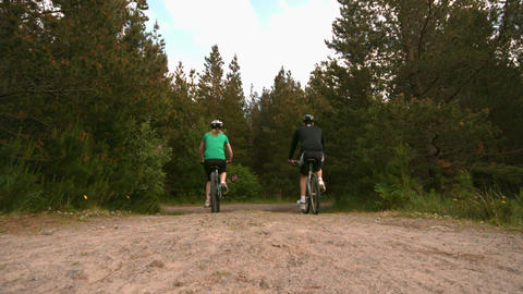 Fit couple mountain biking in the countryside together away from camera Footage