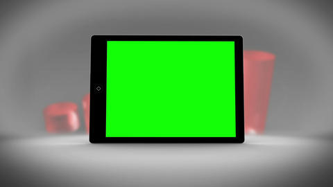 Tablet with green screen in front of statistics Animation