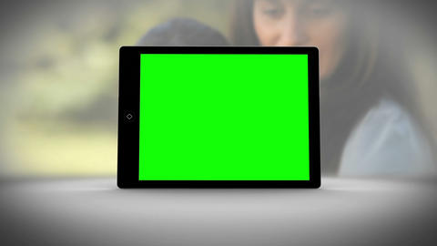 Tablet with green screen in front of family outdoors Animation
