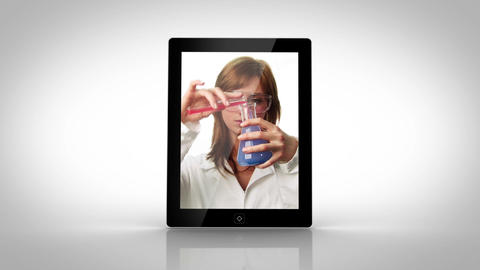 Tablet showing lab assistants Stock Video Footage