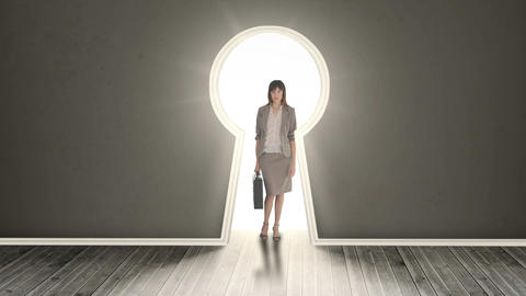 Businesswoman posing in glowing keyhole Animation