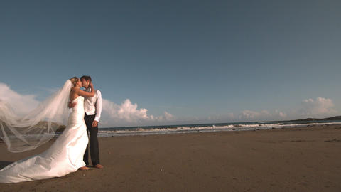 Happy Bridal Couple Kissing On The Beach stock footage