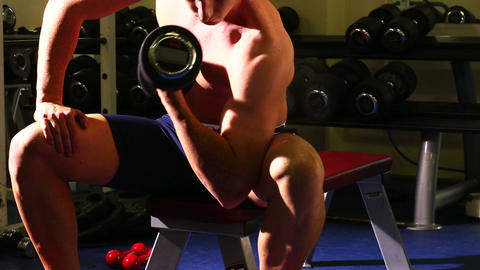 Attractive fit man lifting dumbbell Footage