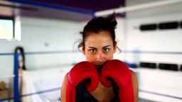 Aggressive fit woman wearing red boxing gloves box Footage