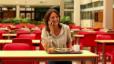 Student answering her phone while having lunch in  Footage