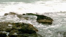 Waves crashing over rocks Footage