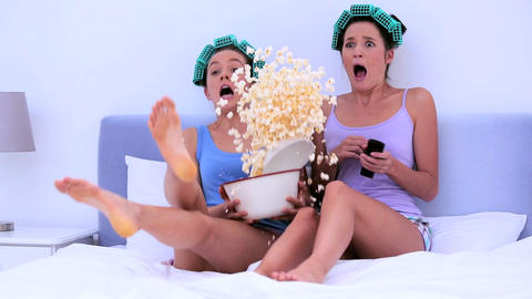 Girls watching a scary movie together Footage