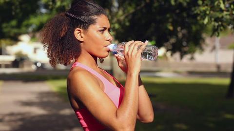 sporty woman drinking water Footage
