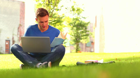 Focused smiling student studying outside Footage
