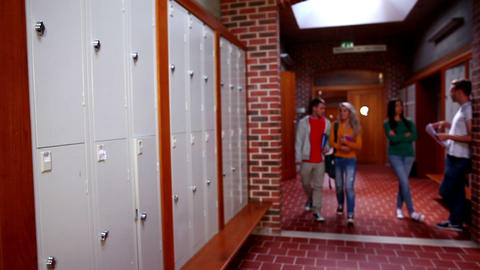 Two students walking and talking in the hallway Footage