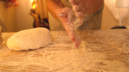 Hands rubbing flour off each other while baking Live Action