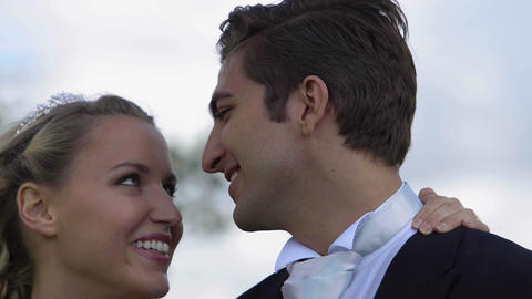 Laughing newlyweds kissing outside Footage