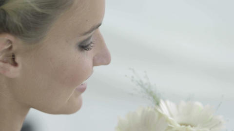 Beautiful bride smelling her bouquet of daisies Footage