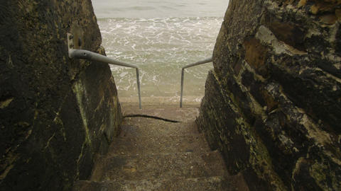 Concrete Stairs Leading Into The Ocean stock footage
