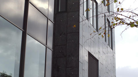 Low angle shot of a tall grey office building Footage