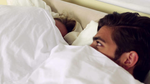 Cute couple hiding under the sheets Footage
