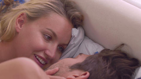 Intimate couple chatting in bed Footage