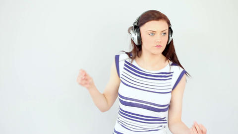Dancing pretty brunette listening to music Footage