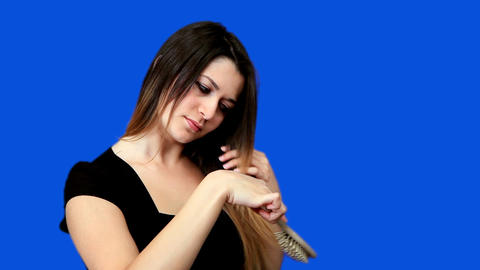 Blue screen beautiful girl comb hair Stock Video Footage