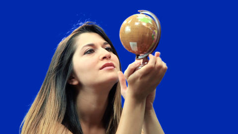 Blue screen beautiful girl hold globe sit Stock Video Footage