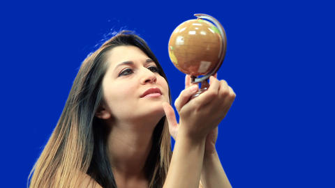 Blue screen beautiful girl hold globe sit Footage