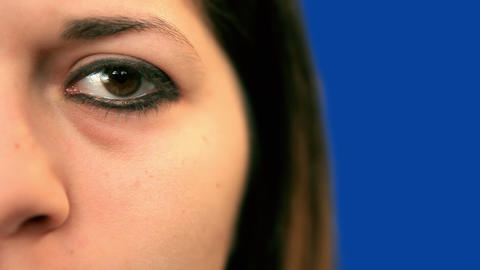 Blue screen beautiful girl left eye extreme close up Stock Video Footage