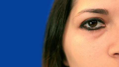 Blue screen beautiful girl right eye extreme close up Stock Video Footage