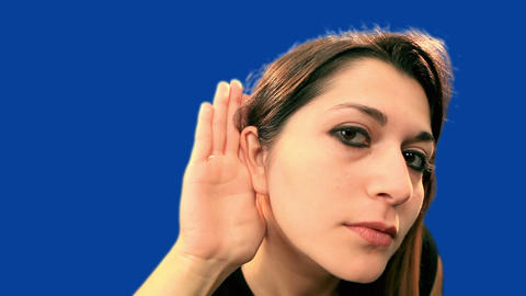 Blue screen beautiful girl try to hear Stock Video Footage