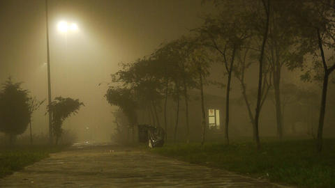 Foggy weather at night small house Stock Video Footage