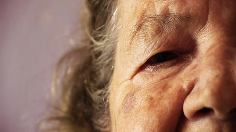 Senior old woman face eye wrinkle skin close up HD Footage