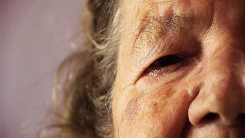 Senior old woman face eye wrinkle skin close up HD Stock Video Footage