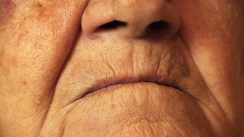 Senior old woman mouth wrinkle skin close up Footage