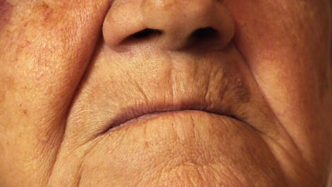 Senior old woman mouth wrinkle skin close up Stock Video Footage