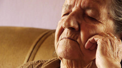 Senior old woman take nap sleep wrinkle skin Stock Video Footage