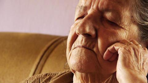 Senior old woman take nap sleep wrinkle skin Stock Video Footage