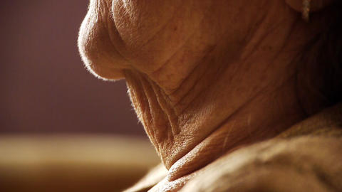 Senior old woman throat neck wrinkle skin close up Footage