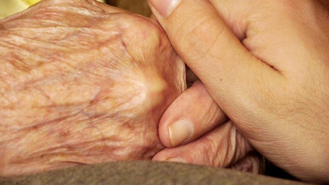 Senior old woman young man hold hand wrinkle skin close up Footage