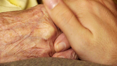 Senior old woman young man hold hand wrinkle skin close up Stock Video Footage