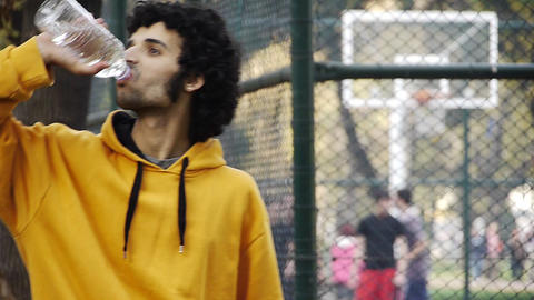 Young man play basketball streetball drink water sport... Stock Video Footage