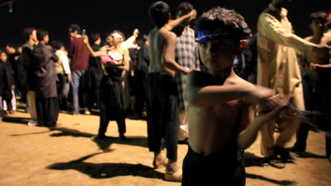 Little Boy performing self flagellation during Ashura... Stock Video Footage