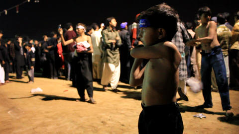 Little Boy performing self flagellation during Ashura Festival in Karachi, Pakistan Footage