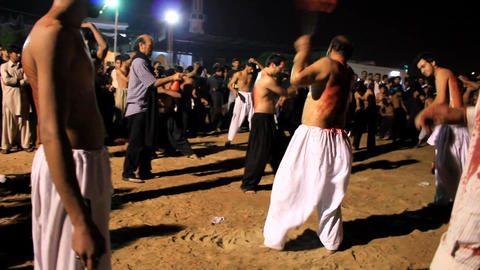 Ritualistic Self Flagellation at Ashura Festival in... Stock Video Footage