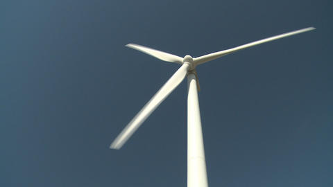 Large wind turbine tilt up shot Footage